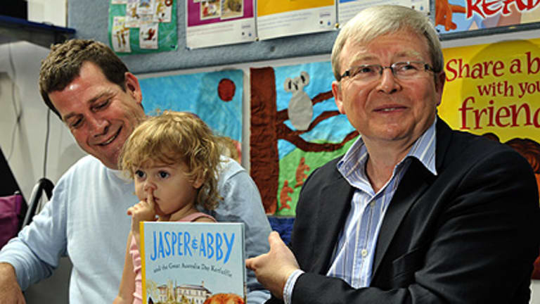 First things first ... Rhys Muldoon and his daughter Lotte, with Kevin Rudd, at yesterday's launch.