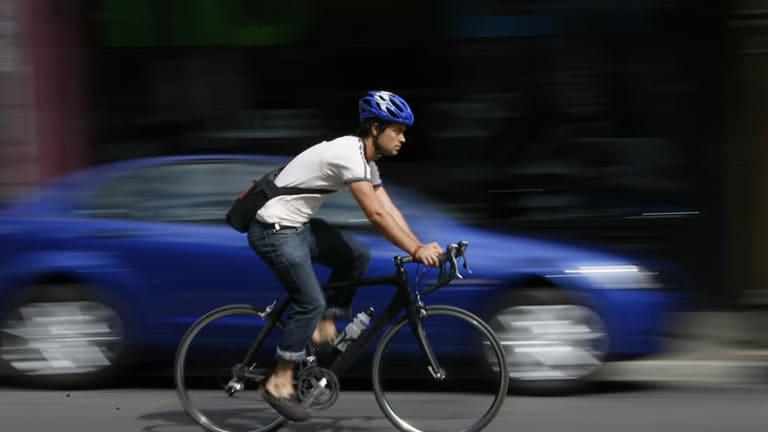 Keep clear ... a cyclist avoiding the door zone.