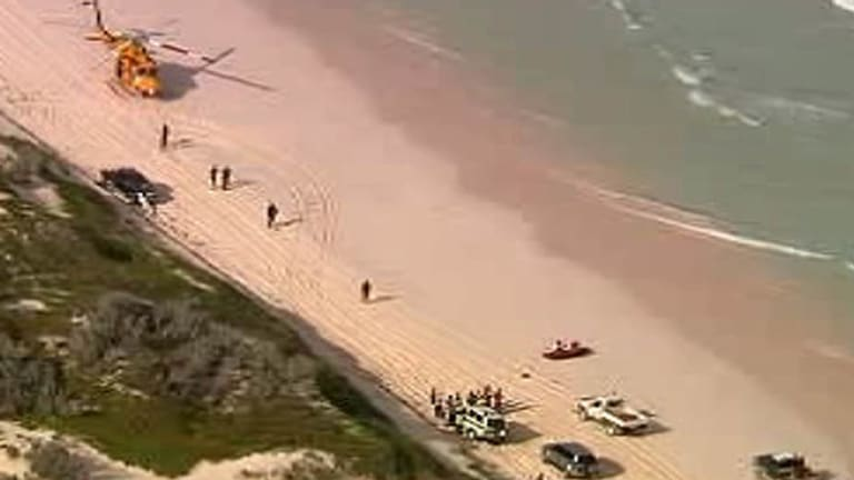 Emergency workers on the beach. <i>Channel Ten</i>