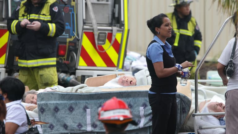 Residents are cared for by emergency crews after being evacuated from the nursing home.