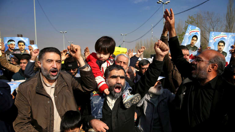 Iranian worshippers chant slogans during a rally against anti-government protesters after Friday prayers in Tehran.
