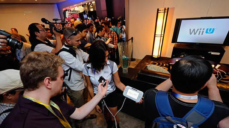 Crowds gather at the Nintendo booth during the Electronic Entertainment Expo where exhibitor Aurielle Rounsaville displays the Wii U.