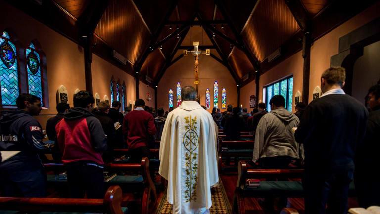 Catholic student priests during morning prayer at Corpus Christi College.