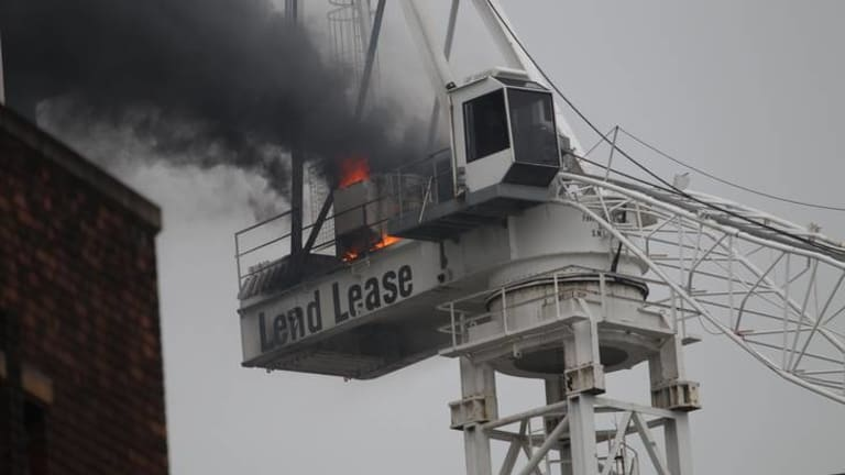The crane on fire.