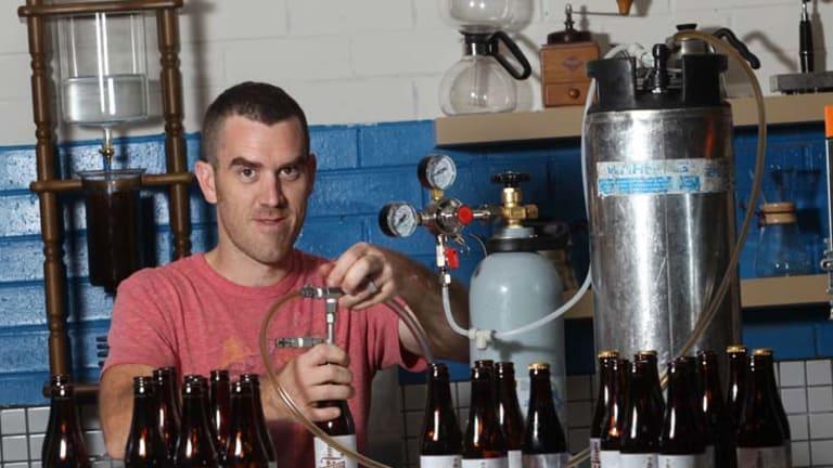 Nolan Hirte at his Footscray factory bottling his cold coffee brew.