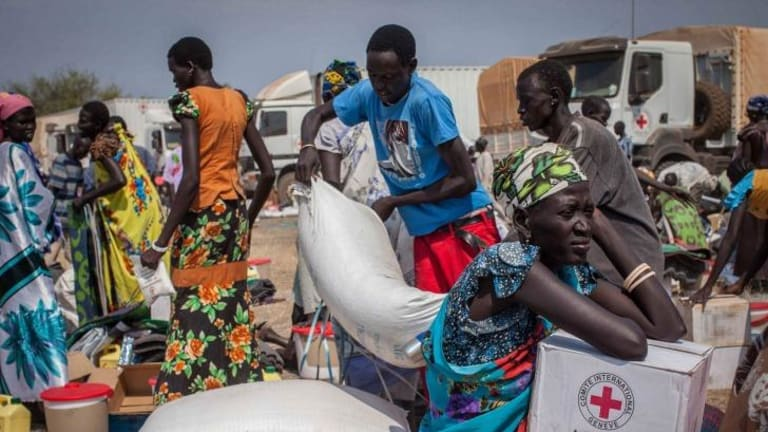 South Sudanese receive aid in January this year in Minkammen, near Bor.