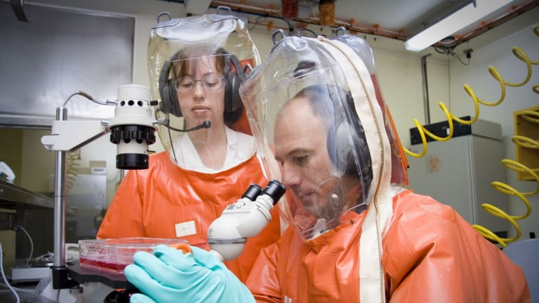 Scientists at the Australian Animal Health Laboratory working at Biosecurity Level 4, the highest security available.