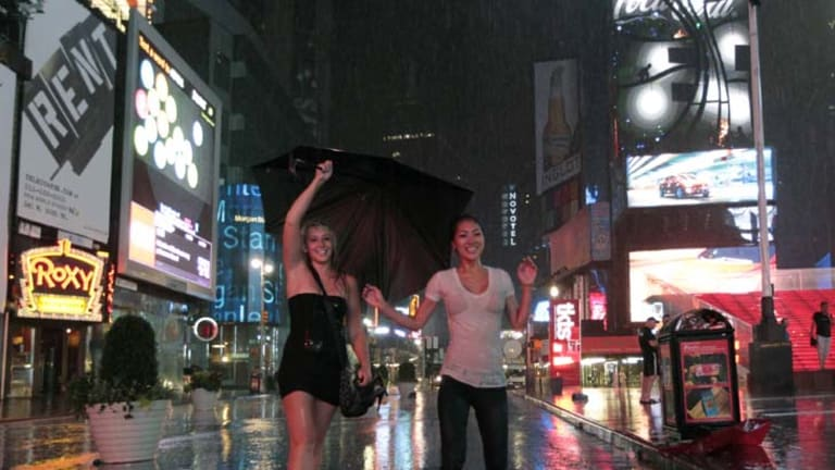 Revellers brave the weather in New York City.