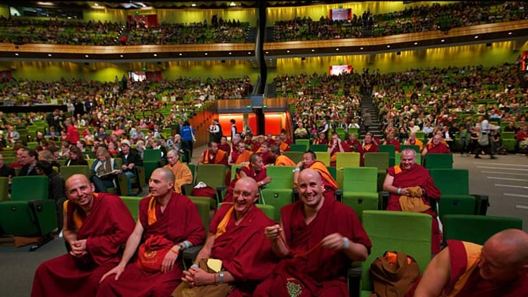 Buddhist Monks share a laugh before his Holiness The Dalai Lama appears to speak at his talk ' Sharing A Conversation With The Dalai Lama' at the Melbourne Convention Centre.