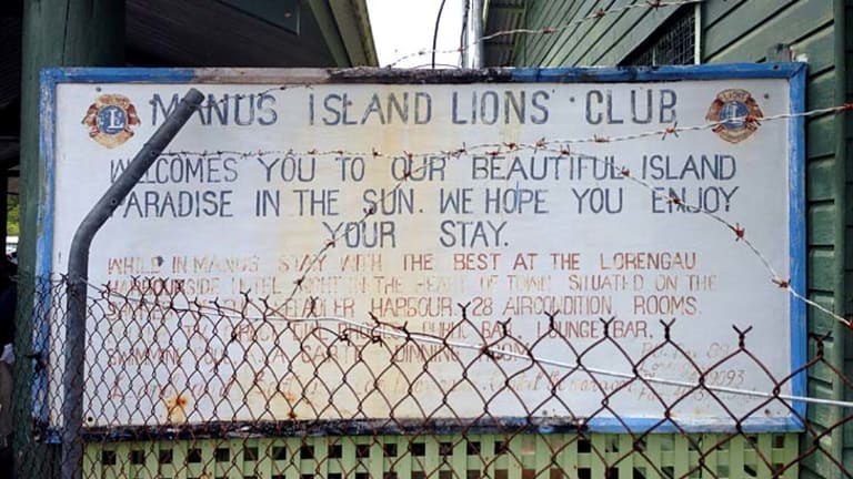 Inadequate care: A Manus Island Lions Club 'welcome' sign greets arrivals at the airport.