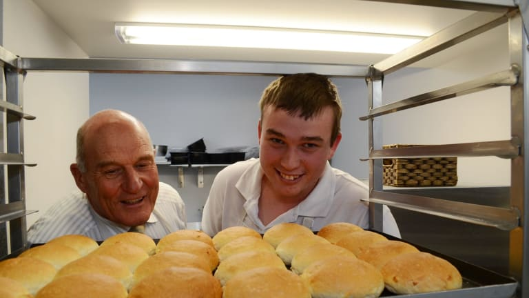 Ballarat Specialist School principal John Burt and apprentice Mark Clough with rolls Mr Clough baked for The Bakery Cafe run by the school.