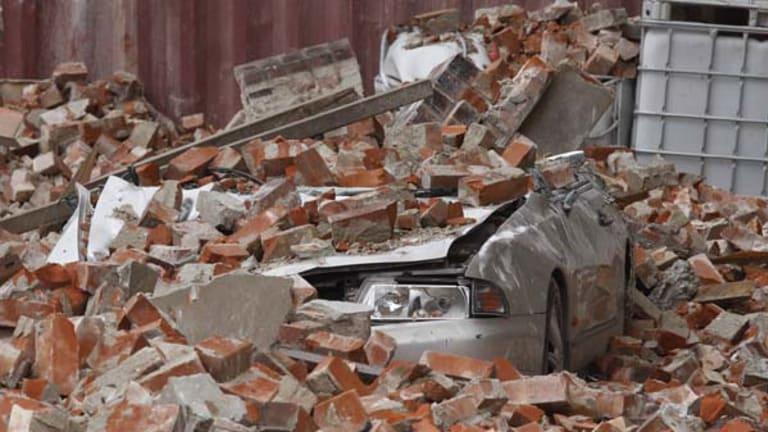 Destruction ... a car sits crushed in Christchurch.