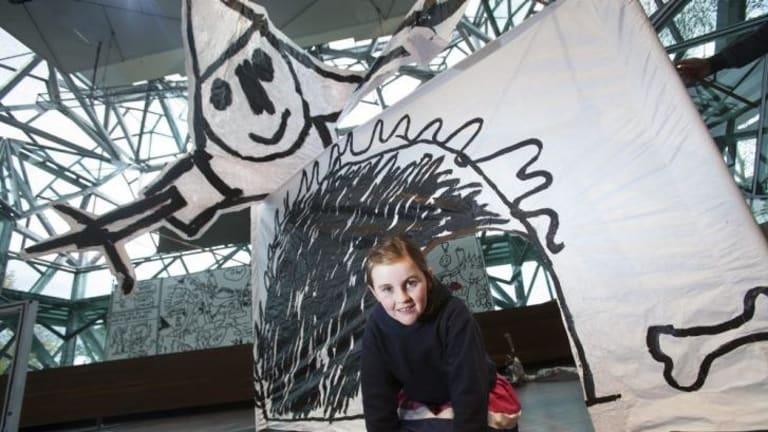 Zoe Thorpe, 6, interacts with Polyglot's <i>Drawbridge</i> at Federation Square.
