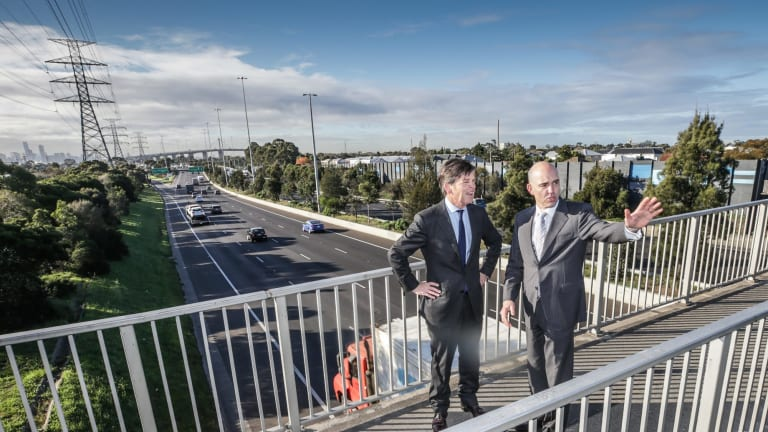 Roads Minister Luke Donnellan and Peter Sammut, chief executive of the Western Distributor Authority, in Yarraville on Monday.