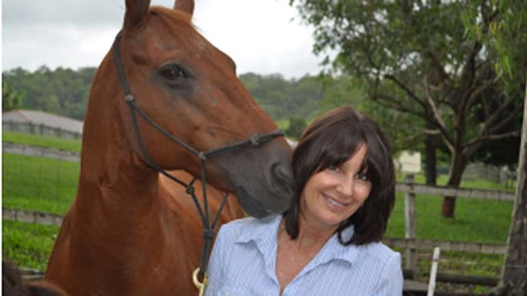 No words needed: Sue Spence with one of her horses.