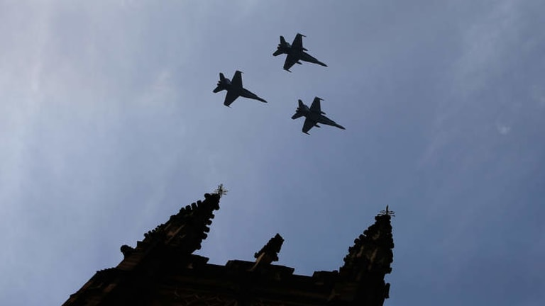 RAAF FA-18 Hornets fly over St Andrew's Cathedral during the memorial service of former Australian Prime Minister Gough Whitlam at Sydney Town Hall