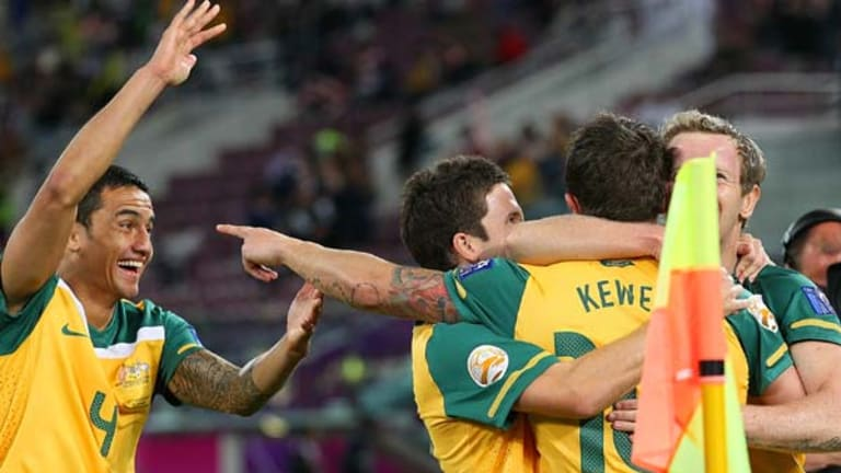 Harry Kewell of Australia celebrates his goal with Tim Cahill, Matt McKay and David Carney.