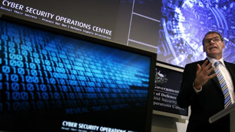 Minister for Defence, Senator John Faulkner officially opens the Defence's new Cyber Security Operations Centre in Canberra in January, 2010. Photo: AAP Image/Stefan Postles