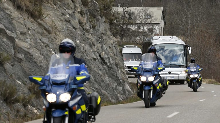 A coach transporting family members and relatives of the victims is escorted by French Gendarmes as they arrive in Seyne-les-Alpes near the crash site of an Airbus A320 in the French Alps.