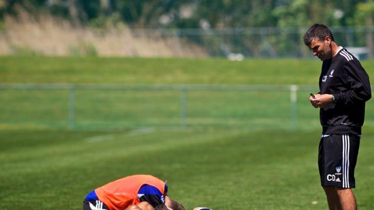 No lying down on the job … Sydney FC chief of human performance Craig Duncan at training.