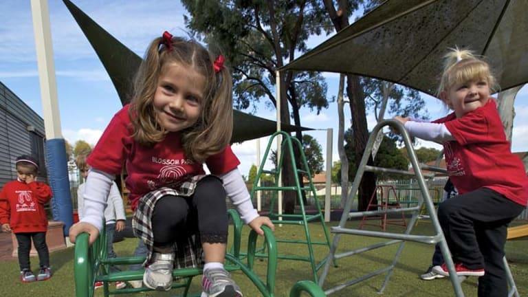 Children play at Blossom Park Kindergarten, Mill Park. The Victorian kindergarten program for four-year-olds is under threat.
