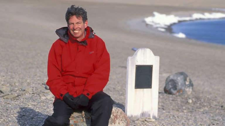 Author John Geiger, at the grave of polar explorer John Torrington, on Beechey Island, North-west Territories, in Canada.