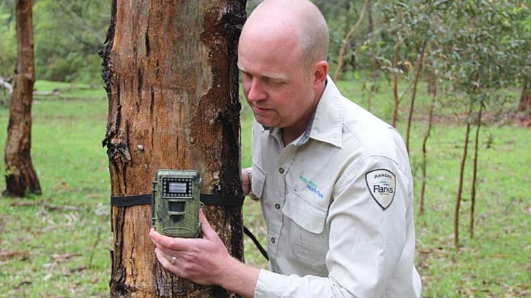 Snap: Ranger Ryan Duffy checks a digital camera.
