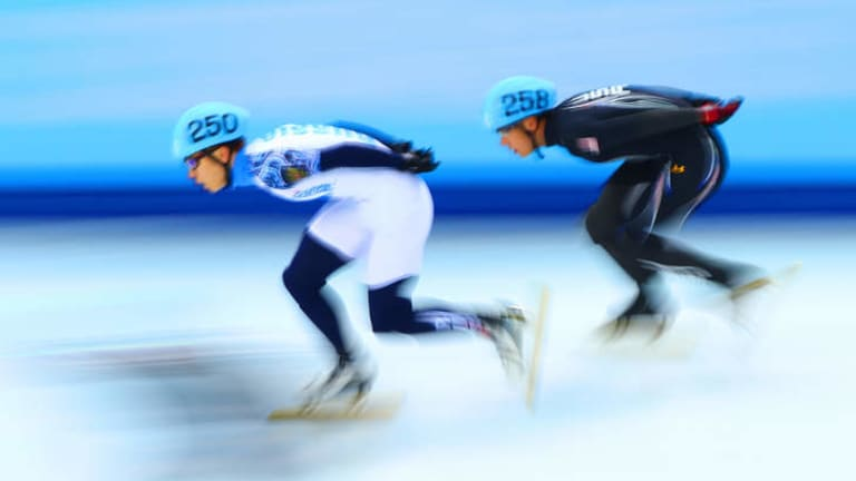 Streaks ahead: Russia's Victor Ahn and J.R. Celski of the United States compete in the Short Track Men's 5000m Relay.