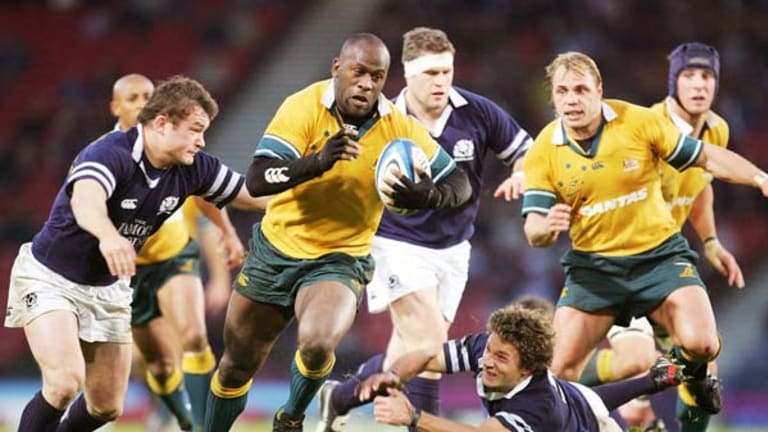 Former Wallaby Wendell Sailor powers through the Scottish backline in 2004.