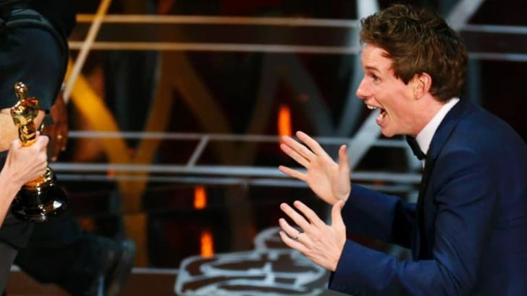 Eddie Redmayne accepts the Oscar for best actor during the 87th Academy Awards in Hollywood.