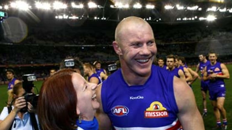 The Prime Minister, Julia Gillard, with Western Bulldogs full forward, Barry Hall.