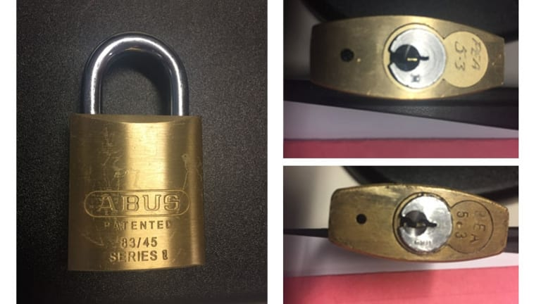 "The padlocks have ""PEA5.3"" engraved on them near the locking mechanism."