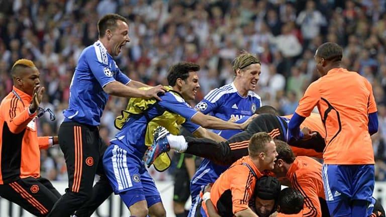 Chelsea players celebrate Didier Drogba's game-winning penalty kick.