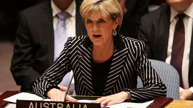Foreign Minister Julie Bishop, pictured speaking at a meeting of the United Nations Security Council, has warned Russia that Australia is poised to increase sanctions.