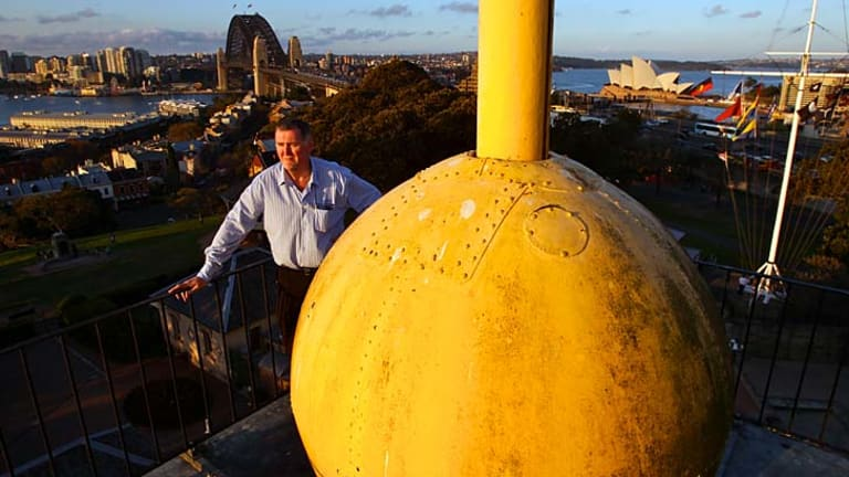 Significant: Sydney Observatory's education officer Geoffrey Wyatt with the time ball, which has dropped every day for 155 years except for two years when it was out of action and required new parts.