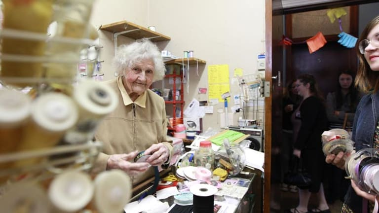 Cool under pressure ... 99-year-old Fay Morley serves her extra customers on Saturday, who could only fit in the tiny store one at a time. Picture: Jacky Ghossein.