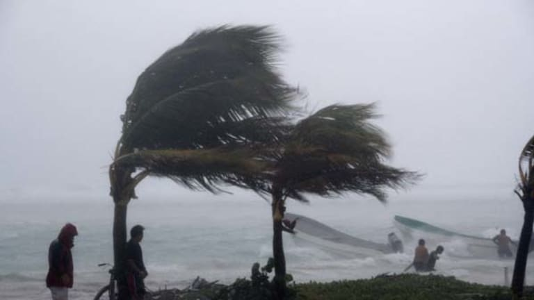 Fishermen try to secure their boats as Hurricane Karl arrives in the town of  Mahahual, southern Mexico, on Wednesday.