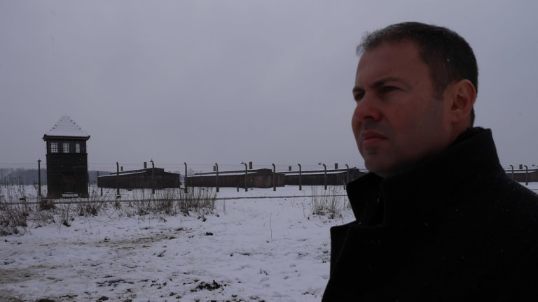 'It's chilling to think so many innocent people lost their lives here': Australia's Assistant Treasurer Josh Frydenberg looks out on the ruins of Auschwitz-Birkenau.