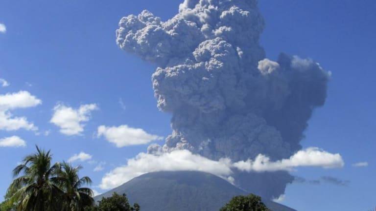 The Chaparrastique volcano in El Salvador volcano spews ash into the air.