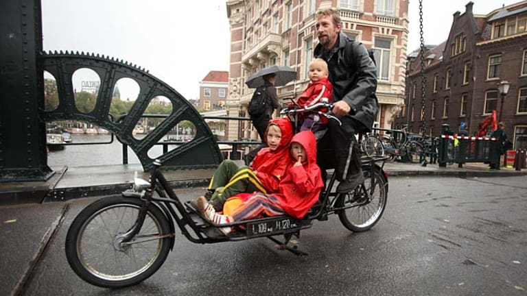 The Netherlands: Dutch children are the happiest in the world. Reyer Meeter is taking his kids on the daily school run, by bicycle.