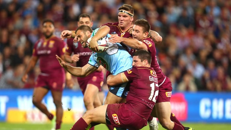 Standards: Wade Graham of the Blues is tackled by Matt Gillett and Josh McGuire of the Maroons during game one of the State Of Origin series last month.