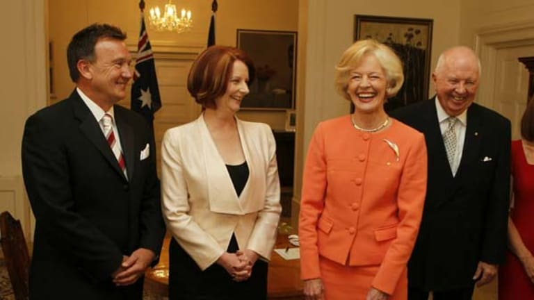 Julia Gillard is sworn in as Prime Minister by Governor-General Quentin Bryce at Government House in Canberra, with her partner Tim Mathieson, left, and Michael Bryce.