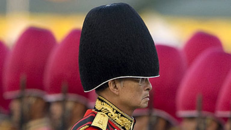 Thailand's King Bhumibol Adulyadej attends the annual Trooping of the Colour military parade in Bangkok's Royal Plaza. The Thai king, the world's longest-reigning monarch, will turn 81 tomorrow.