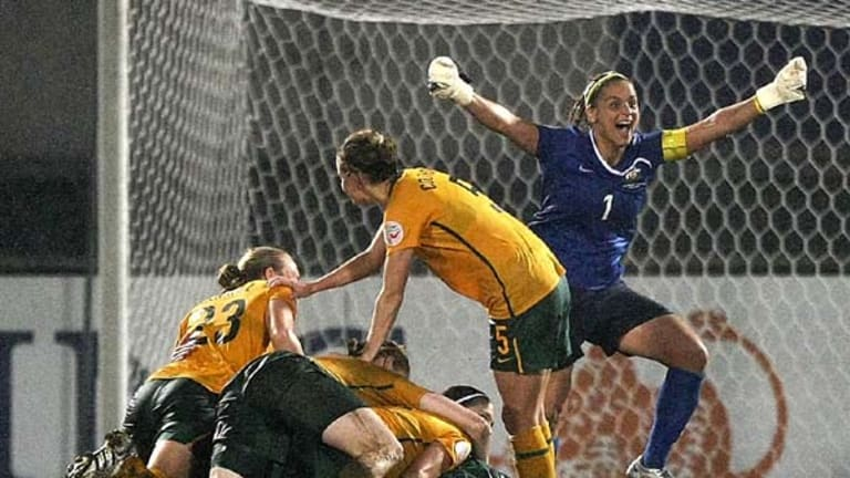 The Matildas celebrate after beating North Korea in a tense  penalty shoot-out.