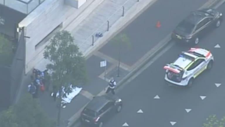Two people were shot dead outside police HQ in Parramatta.