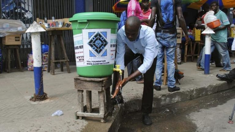 A man washes his hands as a preventive measure in Monrovia.