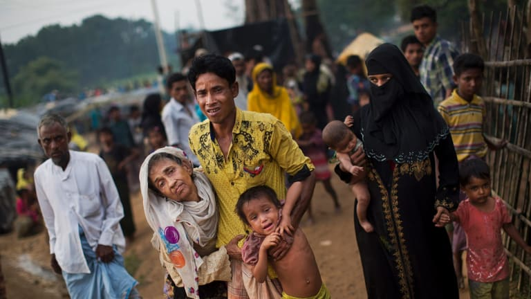 Exhausted Rohingya arrive at Kutupalong refugee camp in Bangladesh.