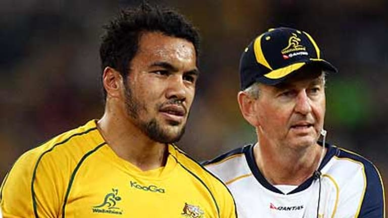 Wallabies winger Digby Ioane is led from the field with a dislocated shoulder.