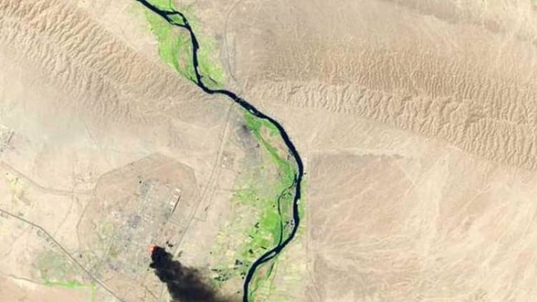 A satellite view of the battle from Baiji last month shows smoke billowing from Iraq's largest oil refinery complex.