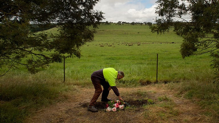 Bruce Wood tends the now-bare Jill Meagher memorial after the local council removed a granite tribute.